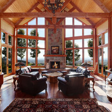 Rustic Living Room by Associated Designs, Inc.