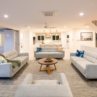 Contemporary formal open concept living room in Cairns with white walls, no fireplace, no tv and beige floor.