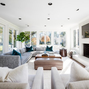 Transitional formal and enclosed medium tone wood floor living room photo in New York with white walls, a standard fireplace, a brick fireplace and a wall-mounted tv