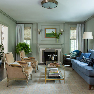 Living room - traditional dark wood floor living room idea in New York with green walls and a standard fireplace