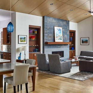 Inspiration for a mid-sized rustic open concept light wood floor and beige floor living room remodel in Denver with a bar, white walls, a ribbon fireplace, no tv and a tile fireplace