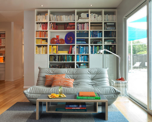 Inspiration For A Midcentury Modern Living Room Remodel In Other With Library And Light Wood