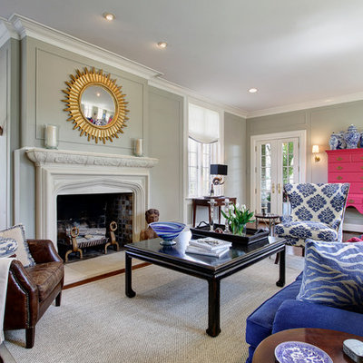 Elegant living room photo in Columbus with green walls, a standard fireplace and no tv