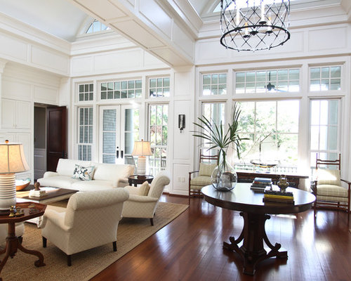 Example Of A Huge Eclectic Living Room Design In Charleston With White Walls