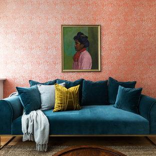 Ispirazione per un piccolo soggiorno eclettico con pareti rosse