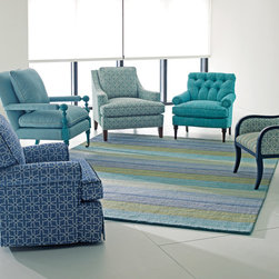 Brushstroke Blue Rug & Chair Collection - Stripes of striated color meld across this rug like paint-laden brushstrokes. This season, we are happy to offer two new colorways, a pastel willow hue, and a soothing blue tone. No matter which one you choose the rich mélange of colors work in a wide range of settings.