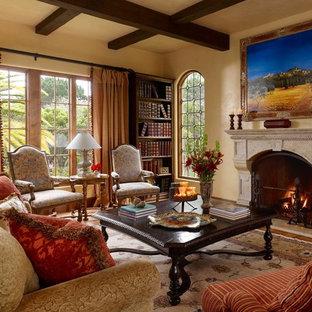 フェニックスの大きい地中海スタイルのおしゃれなLDK (フォーマル、無垢フローリング、標準型暖炉、石材の暖炉まわり、テレビなし、ベージュの壁、茶色い床) の写真