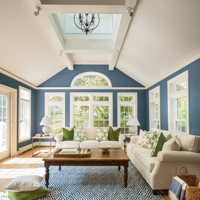 Inspiration for a large timeless formal and enclosed light wood floor living room remodel in Boston with blue walls, no fireplace and no tv