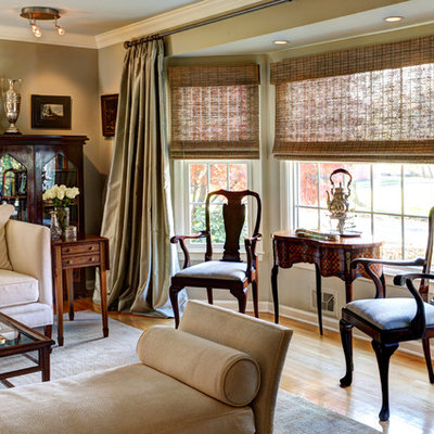 Example of a classic formal light wood floor and brown floor living room design in New York with beige walls
