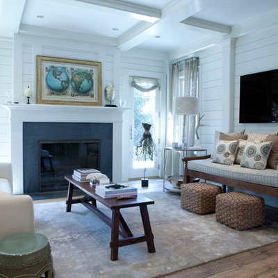 Living room - mid-sized coastal open concept light wood floor living room idea in New York with white walls, a wall-mounted tv, a standard fireplace and a stone fireplace