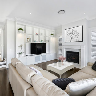 Inspiration for a large transitional open concept living room in Sydney with white walls, dark hardwood floors, a standard fireplace, a brick fireplace surround, a freestanding tv and brown floor.