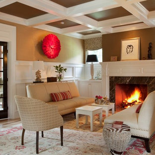 Example of a mid-sized transitional living room design in Boston with brown walls and a standard fireplace