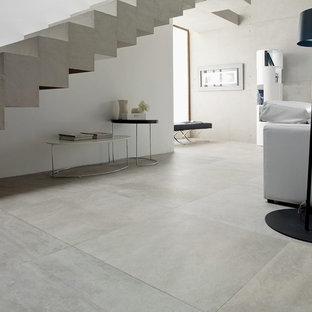 Esempio di un grande soggiorno industriale aperto con pavimento in gres porcellanato, pareti bianche, nessun camino, nessuna TV e sala formale