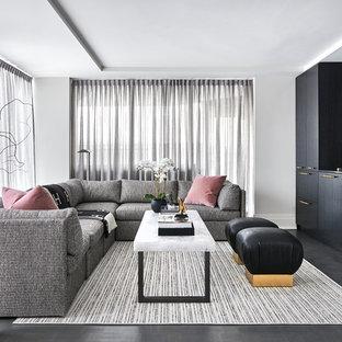 Immagine di un soggiorno contemporaneo di medie dimensioni e aperto con angolo bar, pareti bianche, nessun camino, TV a parete, pavimento grigio e pavimento in vinile