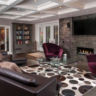 シカゴの大きいコンテンポラリースタイルのおしゃれなLDK (マルチカラーの壁、標準型暖炉、タイルの暖炉まわり、埋込式メディアウォール) の写真