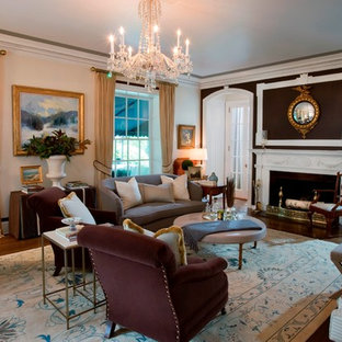 Example of a classic living room design in New York with brown walls and a standard fireplace