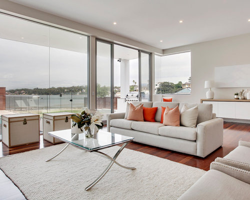 this is an example of a contemporary living room in sydney with beige walls and dark