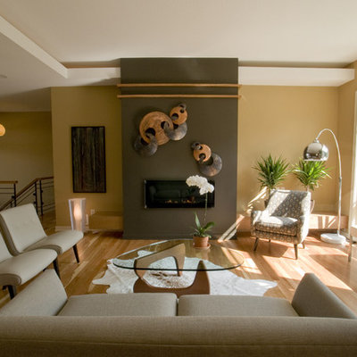 Inspiration for a contemporary living room remodel in Minneapolis with yellow walls and a ribbon fireplace