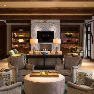 マイアミのおしゃれなLDK (黄色い壁、カーペット敷き、標準型暖炉、壁掛け型テレビ) の写真