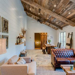 Ejemplo de salón para visitas abierto, rural, de tamaño medio, sin chimenea y televisor, con paredes blancas y suelo de pizarra
