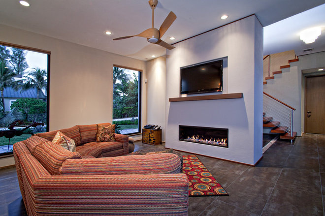 Tropical Living Room by Village Architects AIA, Inc.