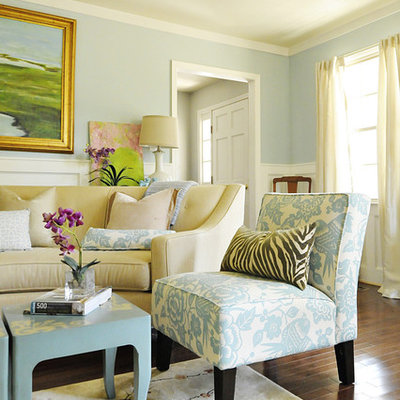 Elegant living room photo in Charleston with blue walls
