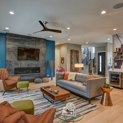 Large trendy open concept light wood floor living room photo in Indianapolis with a bar, a standard fireplace, a tile fireplace and a wall-mounted tv