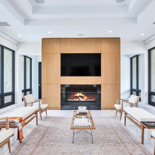 This is an example of a medium sized contemporary open plan living room in Tampa with marble flooring, a wooden fireplace surround, white floors, white walls, a ribbon fireplace and a built-in media unit.