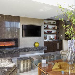 Esempio di un grande soggiorno contemporaneo stile loft con sala della musica, pareti grigie, pavimento in marmo, camino ad angolo, cornice del camino in pietra e parete attrezzata