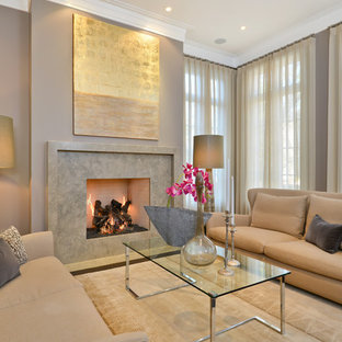 Inspiration for a contemporary living room remodel in Chicago with beige walls and a standard fireplace