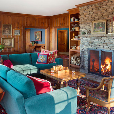 Large elegant enclosed medium tone wood floor living room photo in Boston with brown walls, a standard fireplace and a stone fireplace