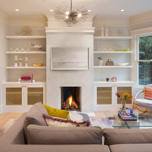 На фото: гостиная комната среднего размера в стиле современная классика с фиолетовыми стенами, светлым паркетным полом, стандартным камином, фасадом камина из плитки и скрытым ТВ