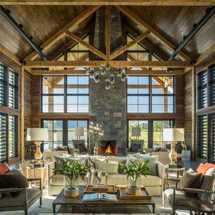 Exemple d'un salon nature ouvert avec une salle de réception, un mur marron, une cheminée standard et un manteau de cheminée en pierre.