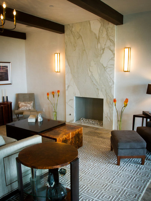 Example Of A Trendy Living Room Design In Santa Barbara With White Walls