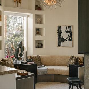 Foto de salón para visitas abierto, contemporáneo, pequeño, con suelo de travertino, suelo beige, paredes blancas, chimenea de doble cara y marco de chimenea de piedra
