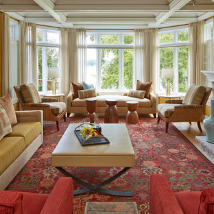 Example of a classic living room design in Minneapolis with yellow walls