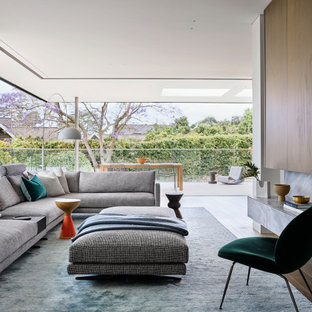 Inspiration for a large contemporary living room in Sydney with medium hardwood floors and brown floor.