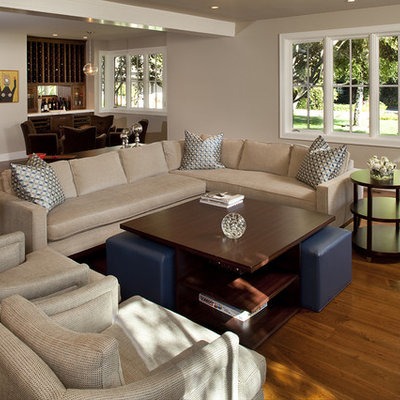 Example of a trendy open concept living room design in San Francisco with beige walls