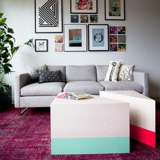 Immagine di un piccolo soggiorno minimal con pareti bianche e moquette