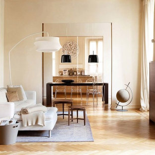 Example Of A Trendy Light Wood Floor Living Room Design In Other With Beige Walls