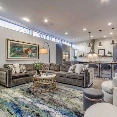 Example of a mid-sized trendy open concept concrete floor and gray floor living room design in Oklahoma City with white walls