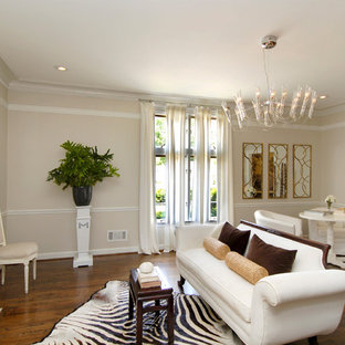 Inspiration for a transitional enclosed dark wood floor living room remodel in Atlanta with beige walls and a standard fireplace