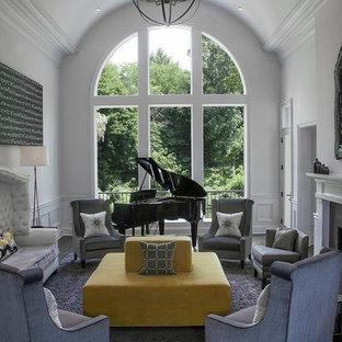 Foto di un soggiorno contemporaneo con sala della musica e pareti bianche