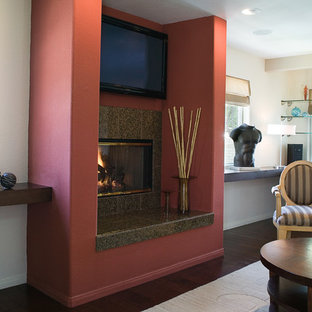 Mid-sized trendy open concept dark wood floor living room photo in San Diego with white walls, a standard fireplace, a stone fireplace and a wall-mounted tv
