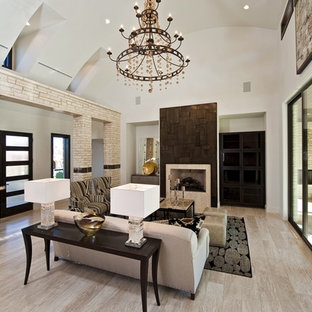 Example of a large trendy living room design in Austin with a standard fireplace