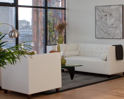 Example Of A Trendy Living Room Design In Vancouver With White Walls