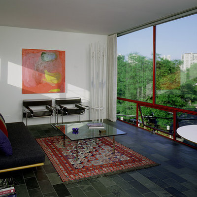 Example of a mid-sized trendy enclosed living room design in Chicago with white walls