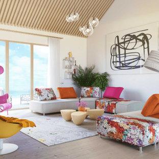 ロサンゼルスの大きいビーチスタイルのおしゃれなLDK (フォーマル、白い壁、合板フローリング、両方向型暖炉、コンクリートの暖炉まわり、埋込式メディアウォール、ベージュの床) の写真