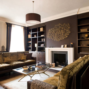 Design ideas for a contemporary living room in London with a reading nook, brown walls, a standard fireplace and no tv.