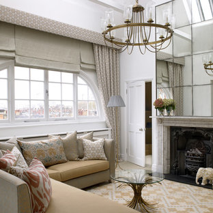 Photo of a contemporary living room in London with a standard fireplace and a stone fireplace surround.